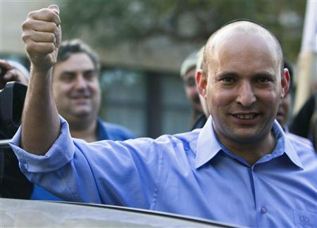Naftali Bennett, leader of the Bayit Yehudi party, gestures after casting his vote for the parliamentary election at a polling station in Raanana, near Tel Aviv January 22, 2013. REUTERS/Nir Elias
