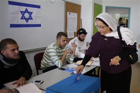 A Druze woman casts her ballot for the parliamentary election at a polling station in the northern Druze-Arab village of Maghar January 22, 2013. REUTERS/Ammar Awad