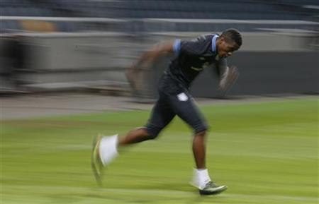 England's Wilfried Zaha warms up during a training session at the Friends Arena in Stockholm November 13, 2012. England are set to play Sweden in an international friendly soccer match on Wednesday. REUTERS/Phil Noble/Files