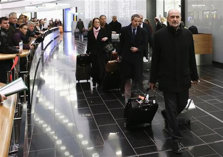 Herman Nackaerts, head of a delegation of the International Atomic Energy Agency (IAEA), pulls his suitcases at the airport in Vienna after arriving from Iran January 18, 2013. REUTERS/Leonhard Foeger