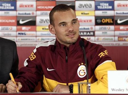 Dutch playmaker Wesley Sneijder poses for media during a signing ceremony in Istanbul January 22, 2013. REUTERS/Osman Orsal