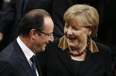 German Chancellor Angela Merkel chats with French President Francois Hollande after a joint meeting of the German lower house of parliament, Bundestag and French National Assembly at the Reichstag in Berlin January 22, 2013, during a day of celebrations marking the 50th Anniversary of the Elysee Treaty that sealed a reconciliation between the former adversaries. REUTERS/Tobias Schwarz