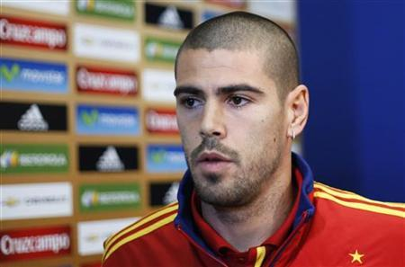 Spain's national soccer player Victor Valdes leaves after his news conference during the Euro 2012 in Gniewino, June 20, 2012. REUTERS/Juan Medina/Files