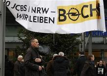 Workers of European carmaker Opel leave a staff meeting in Bochum December 10, 2012. REUTERS/Ina Fassbender