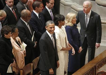 U.S. President Barack Obama (Front, L-R), his wife Michelle Obama, Jill Biden, and her husband Vice President Joe Biden take their seats at the start of the Presidential Inaugural Prayer Service at the National Cathedral in Washington, January 22, 2013. REUTERS/Jonathan Ernst
