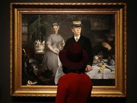 Visitors look at ''The Luncheon'' from 1868 by Edouard Manet in an exhibition entitled ''Manet: Portraying Life'' at the Royal Academy in London January 22, 2013. REUTERS/Suzanne Plunkett