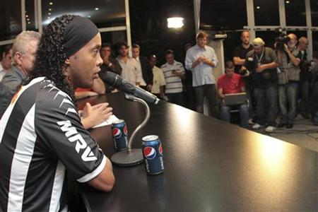 Brazilian soccer player Ronaldinho speaks during a news conference after signing with club Atletico Mineiro in Belo Horizonte in this June 4, 2012 file photo. REUTERS/Gualter Naves/Files