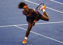 Serena Williams of the U.S. reacts during her women's singles match against Maria Kirilenko of Russia at the Australian Open tennis tournament in Melbourne January 21, 2013. REUTERS/Navesh Chitrakar