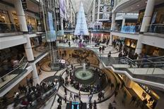 People go shopping in the Eaton Centre shopping mall as they walk by a giant Christmas Tree in Toronto, December 7, 2012. REUTERS/Mark Blinch
