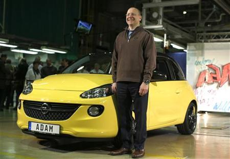 General Motors Vice Chairman, interim President of GM Europe and Chairman of the Opel Supervisory Board Steve Girsky poses in front of an Opel Adam car during the start of the car production in Eisenach January 10, 2013. REUTERS/Lisi Niesner
