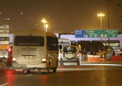 Russian nationals evacuated from Damascus arrive in a convoy at Beirut international airport January 22, 2013. REUTERS/ Mohamed Azakir (LEBANON - Tags - Tags: POLITICS CIVIL UNREST)