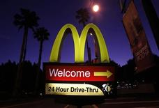 A McDonald's restaurant's drive-thru sign is pictured in Los Angeles April 4, 2011. REUTERS/Mario Anzuoni