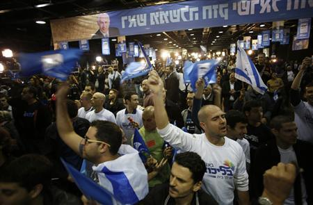 Supporters of Prime Minister Benjamin Netanyahu's Likud party celebrate after the exit polls were announced at the party's headquarters in Tel Aviv January 22, 2013. REUTERS/Baz Ratner (ISRAEL - Tags: POLITICS ELECTIONS)