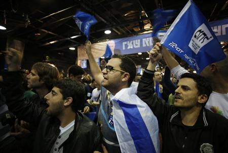 Supporters of Prime Minister Benjamin Netanyahu's Likud party celebrate after the exit polls were announced at the party's headquarters in Tel Aviv January 22, 2013. REUTERS/Baz Ratner