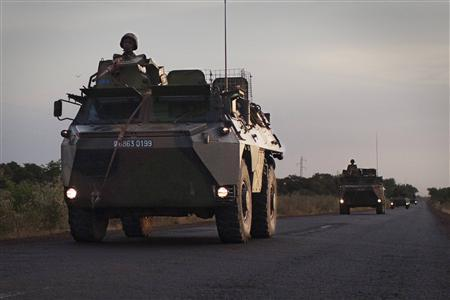 A convoy of French military vehicles drive on a road outside Markala, Mali, January 22, 2013. REUTERS/Joe Penney