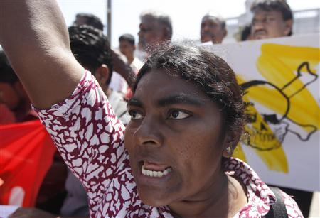 A demonstrator shouts slogans during a rally to protest against what they say is a suppressive amendment to the criminal law in Colombo January 22, 2013. REUTERS/Dinuka Liyanawatte