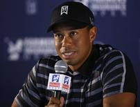 U.S. golfer Tiger Woods speaks during a news conference at the Farmers Insurance Open in San Diego, California, January 22, 2013. REUTERS/Mike Blake
