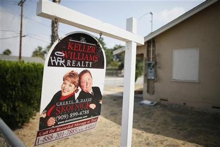 A real estate sign is seen outside a deserted home stripped of its copper wiring in San Bernardino, California September 11, 2012. BERNARDINO/BANKRUPT REUTERS/Lucy Nicholson