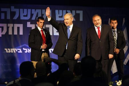 REFILE - CORRECTING DATE Israel's Prime Minister Benjamin Netanyahu waves as he stands next to former foreign minister Avigdor Lieberman at the Likud party headquarters in Tel Aviv January 23, 2013. REUTERS/Baz Ratner (ISRAEL - Tags: POLITICS ELECTIONS)