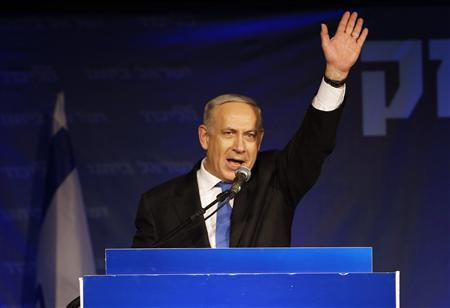 Israel's Prime Minister Benjamin Netanyahu waves to supporters at the Likud party headquarters in Tel Aviv January 23, 2013. Hawkish Prime Minister Netanyahu emerged the bruised winner of Israel's election on Tuesday, claiming victory despite unexpected losses to resurgent centre-left challengers. REUTERS/Baz Ratner (ISRAEL - Tags: POLITICS ELECTIONS)