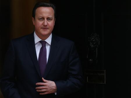 Britain's Prime Minister David Cameron waits outside10 Downing Street to greet Qatar Emir Hamad bin Khalifa al-Thani in central London, January 22, 2013. REUTERS/Andrew Winning
