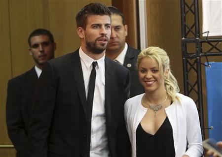 Colombian pop star Shakira walks with her boyfriend, Barcelona soccer player Gerard Pique, in Jerusalem June 21, 2011. REUTERS/Ronen Zvulun/Files