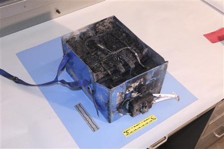 The burnt auxiliary power unit battery removed from a Japan Airlines Boeing 787 Dreamliner jet is seen in this handout photo provided by the U.S. National Transportation Safety Board (NTSB). REUTERS/U.S. National Transportation Safety Board/Handout