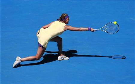 Victoria Azarenka of Belarus hits a return to Svetlana Kuznetsova of Russia during their women's singles quarter-final match at the Australian Open tennis tournament in Melbourne, January 23, 2013. REUTERS/Tim Wimborne
