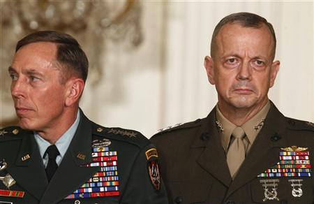 Then U.S. Army Gen. David Petraeus (L) and U.S. Marine Lt. Gen. John Allen stand together in the East Room of the White House during U.S. President Barack Obama's announcement that then CIA Director Leon Panetta would be nominated as Secretary of Defense in this April 28, 2011 file photo. REUTERS/Larry Downing