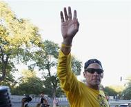Lance Armstrong waves to the crowd following a run with his fans at Mount Royal park in Montreal August 29, 2012. REUTERS/Christinne Muschi