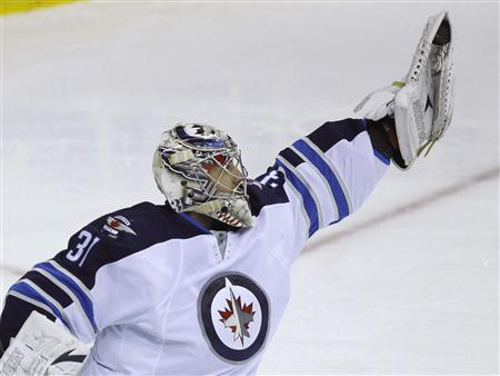 Winnipeg Jets' goalie Ondrej Pavelec makes a save against the Washington Capitals in the third period of their NHL hockey game in Washington January 22, 2013. REUTERS/Gary Cameron