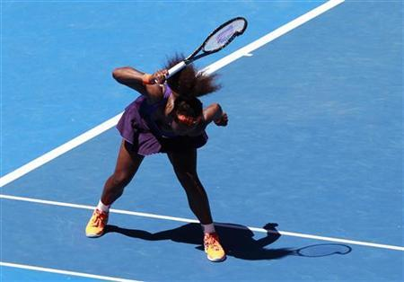 Serena Williams of the U.S. hits her racket into the ground during her women's singles quarter-final match against compatriot Sloane Stephens at the Australian Open tennis tournament in Melbourne January 23, 2013. REUTERS/Daniel Munoz