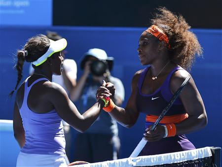 Sloane Stephens of the U.S. shakes hands with compatriot Serena Williams after defeating her in their women's singles quarter-final match at the Australian Open tennis tournament in Melbourne January 23, 2013. REUTERS/Toby Melville
