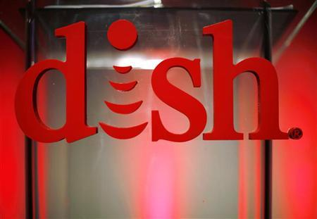 The new logo for DISH is seen on the podium before a news event to promote the company's new logo, products and services at the Consumer Electronics Show opening in Las Vegas January 9, 2012. REUTERS/Rick Wilking