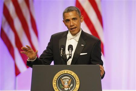 U.S. President Barack Obama speaks at the Commander in Chief's Ball during presidential inauguration ceremonies in Washington, January 21, 2013. REUTERS/Rick Wilking