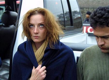 Florence Cassez of France walks with Mexican boyfriend Israel Vallarta (R) after their arrest by members of Mexico's Federal Investigative Agency's (AFI) on a ranch outskirts of Mexico City in this December 9, 2005 photo. REUTERS/Stringer