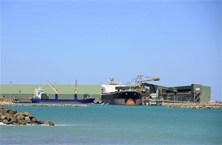 A ship is loaded with iron ore at the port in Geraldton, Western Australia December 3, 2012. REUTERS/Rebekah Kebede