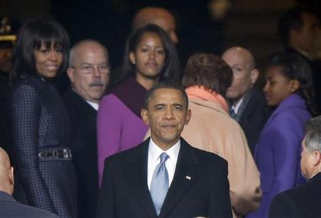 U.S. President Barack Obama turns to look at the crowds gathered on the National Mall as he leaves the podium after his swearing-in ceremonies on the West front of the U.S Capitol in Washington, January 21, 2013. REUTERS/Jason Reed