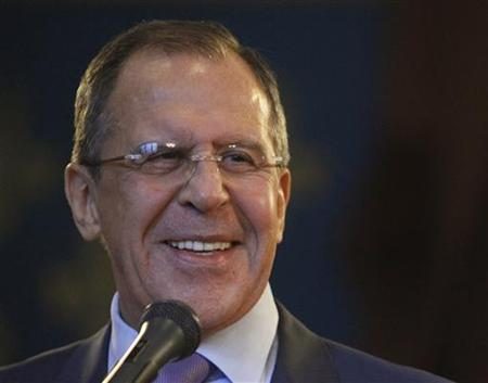 Russia's Foreign Minister Sergei Lavrov smiles during a joint news conference with U.N.-Arab League peace mediator Lakhdar Brahimi of Algeria, in Moscow December 29, 2012. REUTERS/Sergei Karpukhin