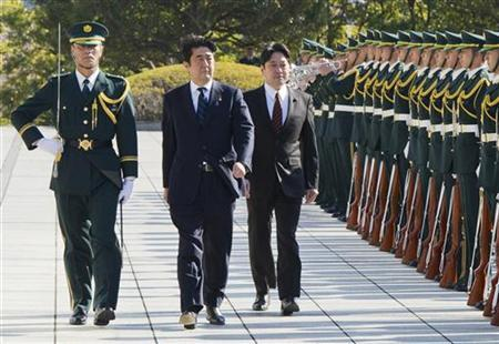 Japan's Prime Minister Shinzo Abe (2nd L) and Defence Minister Itsunori Onodera (3rd L) review an honour guard before a flag return ceremony to mark the return of the Japan Self-Defence Force (JSDF) troops, who were stationed with the United Nations Disengagement Observer Force (UNDOF) in Golan Heights, at the Defence Ministry in Tokyo January 20, 2013. REUTERS/Japan Ministry of Defense/Handout