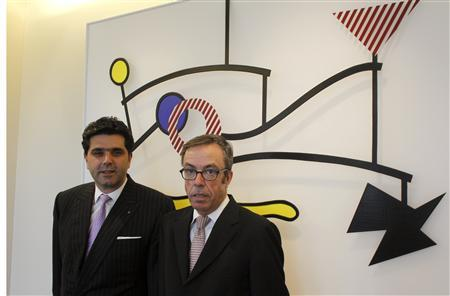CEO Veit de Maddalena and director Harold Rudel (R) of Rothschild Bank AG private bank stand in front of the bas-relief 'Suspended Mobile' from 1990-1991 by U.S. artist Roy Lichtenstein (1923-1997) at the bank's office building in Zurich October 29, 2012. REUTERS/Arnd Wiegmann