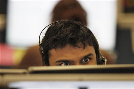 A trader checks screen data at the IG Index trading floor in London, December 9, 2011.REUTERS/Finbarr O'Reilly