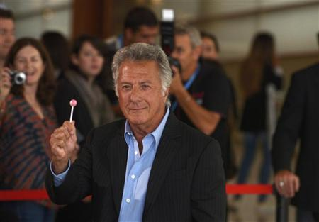 U.S. actor Dustin Hoffman holds up a lollipop taken from a photographer during a photocall to promote his film Quartet at the Kursaal Centre on the final day of the 60th San Sebastian Film Festival September 29, 2012. REUTERS/Vincent West