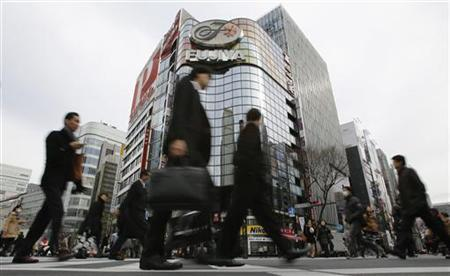Pedestrians cross a street at Tokyo's Ginza shopping district January 23, 2013. REUTERS/Toru Hanai