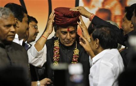 Newly elected President of India's main opposition Bharatiya Janata Party (BJP) Rajnath Singh (C) receives a turban from his supporters after his appointment at the party headquarters in New Delhi January 23, 2013. REUTERS/Mansi Thapliyal