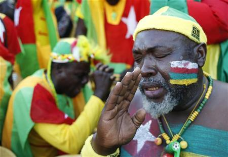Togo supporters pray during their African Nations Cup (AFCON 2013) Group D soccer match against Ivory Coast in Rustenburg, January 22, 2013. REUTERS/Mike Hutchings