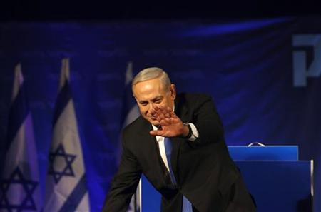 Israel's Prime Minister Benjamin Netanyahu waves upon arrival at the Likud party headquarters in Tel Aviv January 23, 2013. Hawkish Prime Minister Benjamin Netanyahu emerged the bruised winner of Israel's election on Tuesday, claiming victory despite unexpected losses to resurgent centre-left challengers. REUTERS/Baz Ratner (ISRAEL - Tags: POLITICS ELECTIONS)