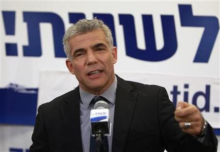 Yair Lapid, leader of the Yesh Atid (There is a Future) party, addresses supporters at his party's headquarters in Tel Aviv January 23, 2013. REUTERS/Ammar Awad