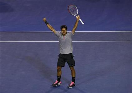 Roger Federer of Switzerland celebrates defeating Jo-Wilfried Tsonga of France in their men's singles quarter-final match at the Australian Open tennis tournament in Melbourne, January 23, 2013. REUTERS/Navesh Chitrakar