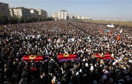 Thousands attend the funeral ceremony of the three Kurdish activists shot in Paris, in Diyarbakir, the largest city in Turkey's mainly Kurdish southeast, January 17, 2013. REUTERS/Umit Bektas